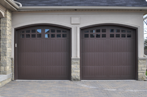 The Differences between Hinged and Sliding Garage Doors